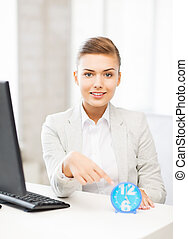 attractive businesswoman pointing at clock - picture of...