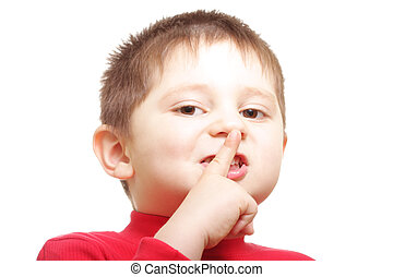 Please dont talk - Closeup photo of boy showing hush gesture