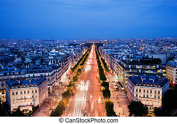 Avenue des Champs-Elysees in Paris, France at night