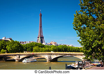 Eiffel Tower and bridge on Seine river in Paris, France....
