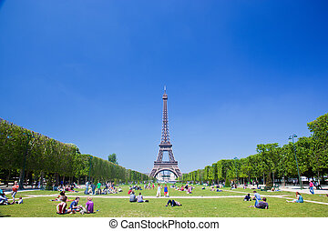 Eiffel Tower, Paris, France. Tourists and locals having a...