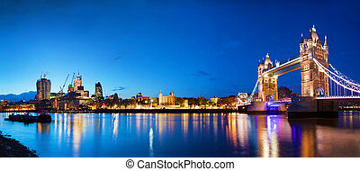 Tower Bridge in London, the UK at night. Panorama of the...