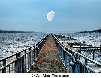 boat dock and moon at dusk