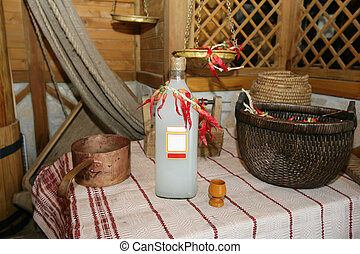 Homemade alcohol - Slavic interior with a bottle of homemade...