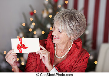 Retired lady with a christmas gift voucher