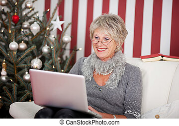 Attractive senior using a laptop - Attractive glamorous...
