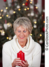 Serene lady with a Christmas candle