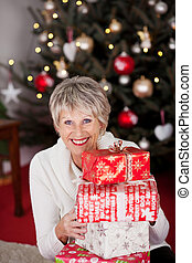 Happy grandmother with Christmas gifts - High angle view of...