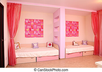 Nursery of pink color with two beds and a partition