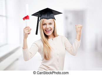 student in graduation cap with certificate - happy student...