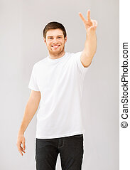 man showing victory or peace sign - young man in white blank...