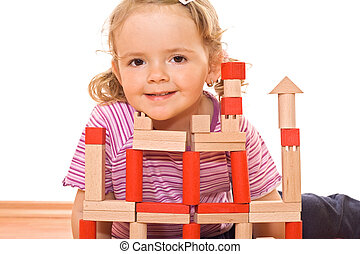 Little girl playing with wooden blocks - Cute girl posing...