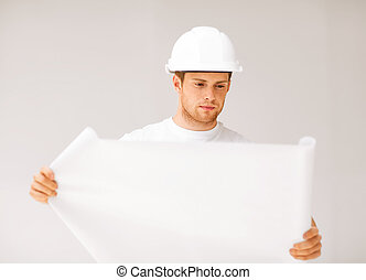 male architect looking at blueprint - picture of male...