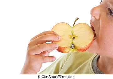 Boy biting an apple slice - Boy eating a slice of apple -...
