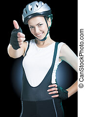 thumbsup - beautiful female bike athlete showing thumbsup...