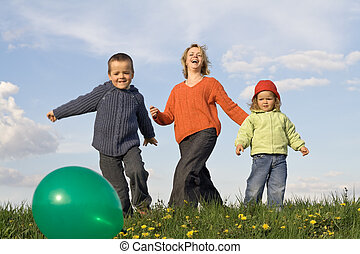 Active happy people outdoors - slight motion blur - Happy...