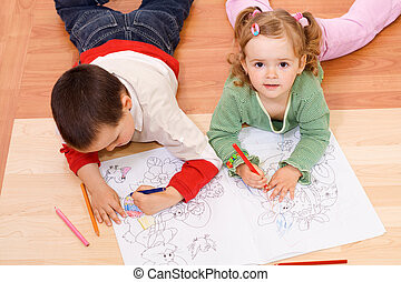 Two kids coloring on the floor - Kids coloring with colored...