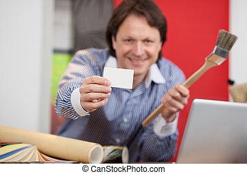 interior designer showing empty card - interior designer in...
