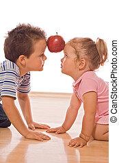 Team effort - Little girl and boy making a team effort to...