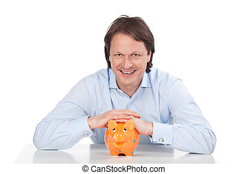 Hopeful man and piggy bank - Hopeful man smiling with his...