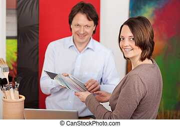 Interior decorator advising a customer - Male interior...