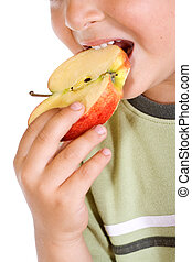 Boys mouth with apple slice - Little boys mouth biting an...