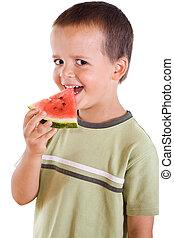 Boy with watermelon slice