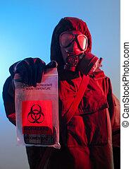 Biohazard soldier holing biohazard bag