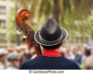 Busker - Street musician playing the bass