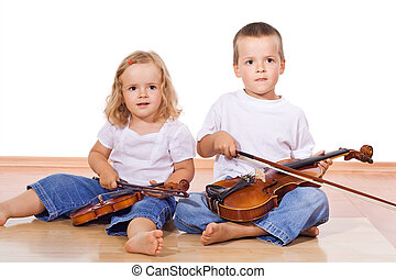 Little boy and girl with violins sitting on the floor -...