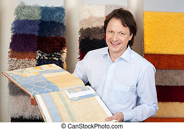 Friendly salesman with fabric samples