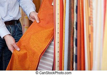 Salesman showing off a fabric sample - Hands of a salesman...