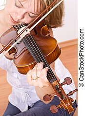 Woman enjoying violin music - Woman sitting and enjoying...