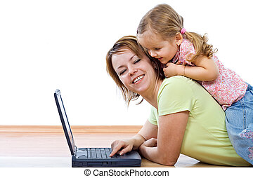 Woman and little girl with laptop