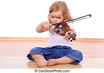 Little girl on the floor with a violin - Little girl sitting...