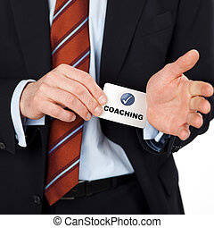 man pulling coaching card - businessman pulling coaching...