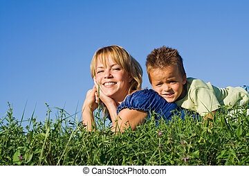 Boy outdoors with his mother