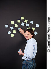 creative man working with post-its