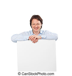 Smiling man with a blank sign board