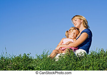 Woman and little girl enjoying sunshine
