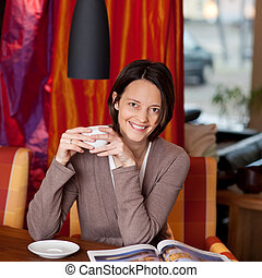 Woman enjoying coffee in a beautiful interior - Attractive...