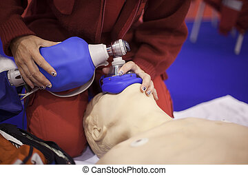 first aid - Demonstrating CPR on a dummy
