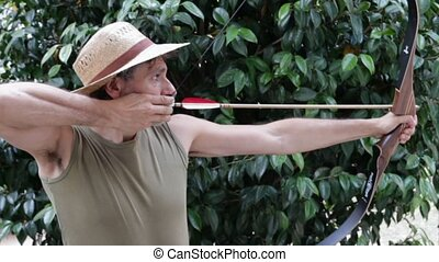 traditional bow - man shooting with a traditional bow