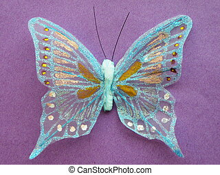 Artificial Butterfly - Pretty artificial butterfly on purple...