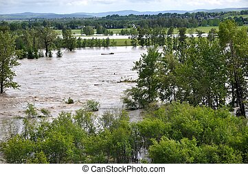A Flooding River - A view of a rapidly flowing muddy river...