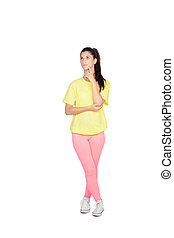 Pensive brunette woman with sport clothing isolated on a...