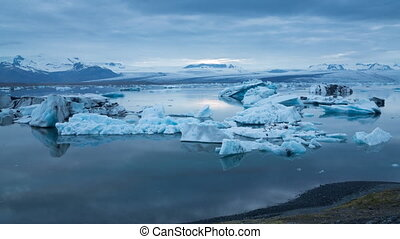 blue icebergs floating under midnight sun - Midnight sun...