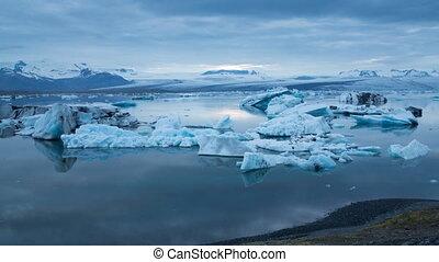 blue icebergs floating under midnight sun - Midnight sun...