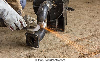 Metal industry worker grinding