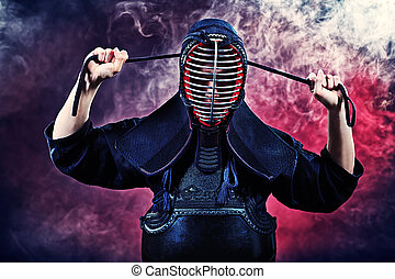 protective clothing - Handsome young man practicing kendo....